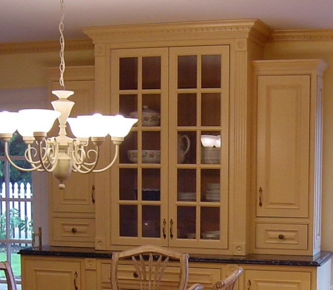 yellow hutch across from kitchen
