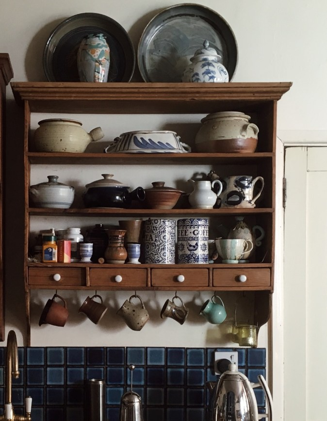 apothecary drawers in open shelf unit