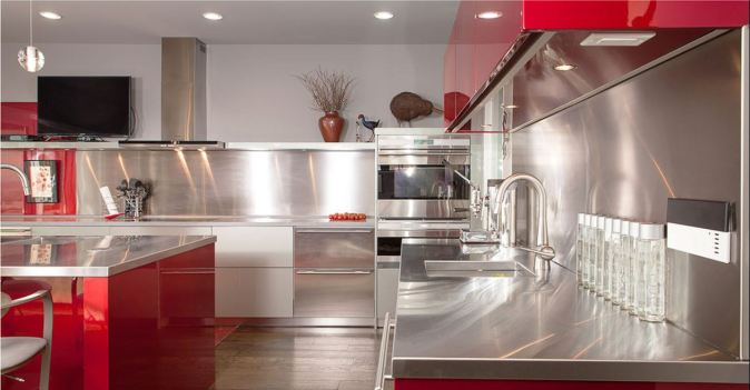 counters and backsplash in stainless steel