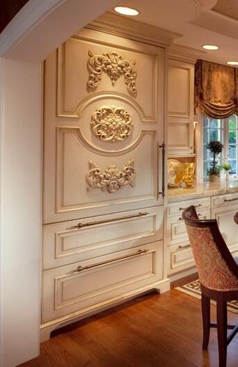 Refrigerator panels in ornate kitchen design