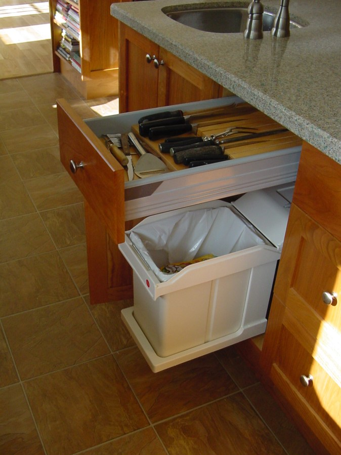 pullout compost bin below knife and utensil drawer