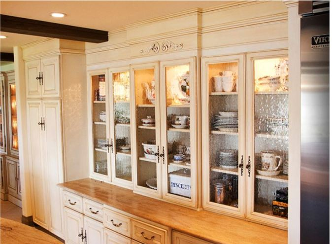 Serving Zone area with glass door cabinets to the countertop and drawers below.