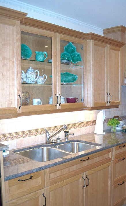 Glass door cabinets recessed above sink