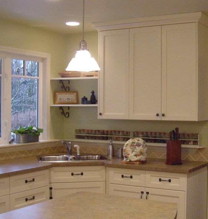 white kitchen with corner sink