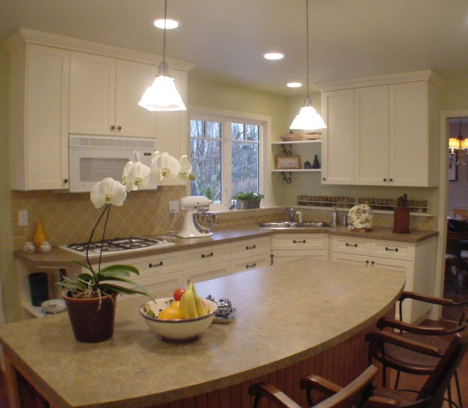 white shaker kitchen with laminate counters