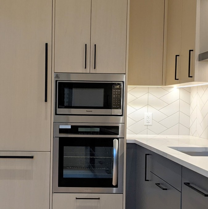 mw and wall oven in modern kitchen
