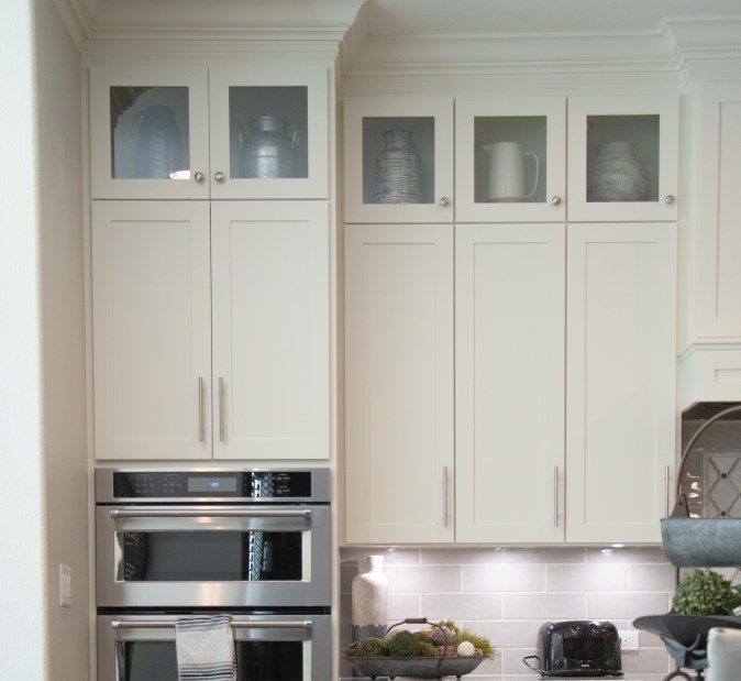 wall cabinets in glass stacked above standard wall cabinets