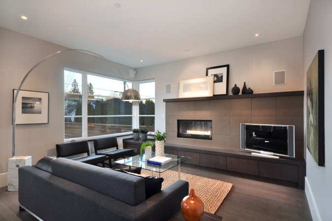 Vestabul designed fireplace wall in family room.