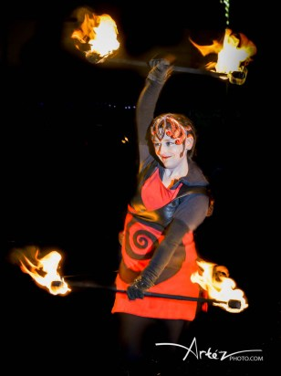 Beautiful fire dancer with Double Staff