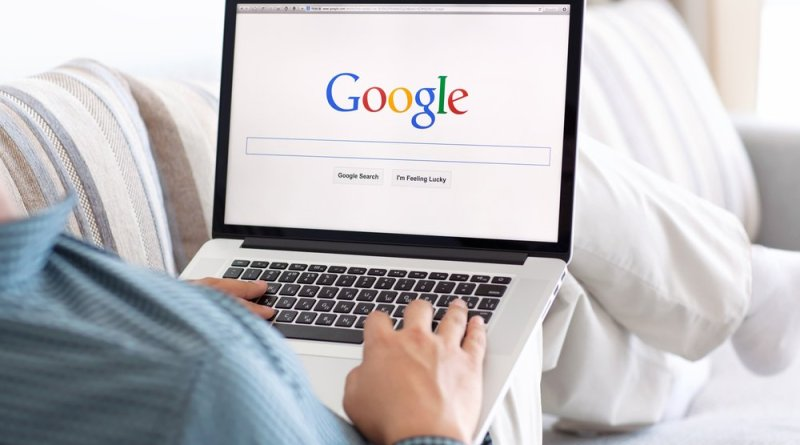 man sitting at the MacBook retina with site Google on the screen