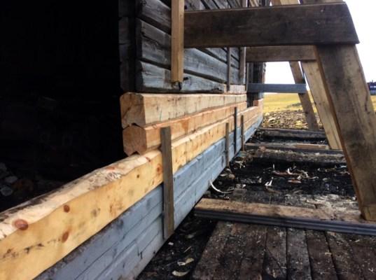 Restaurering laftet vegg svalbard