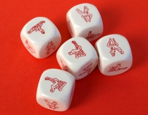 Erotic dices on red background