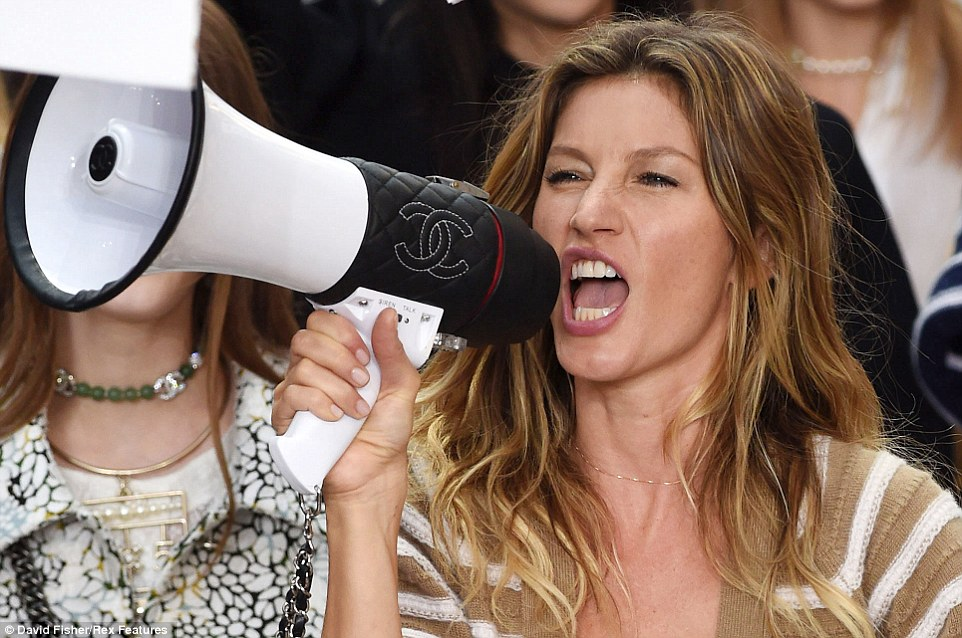 Gisele Bündchen holds a Chanel-branded megaphone at the brand's spring/summer 2015 runway show.