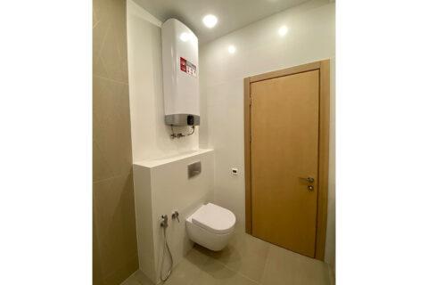 white bathroom with toilet