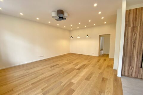 spacious room with wooden floor