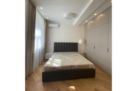 light bedroom wth double bed