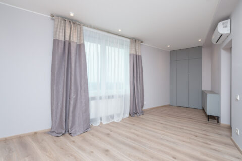 spacious room with air conditioner