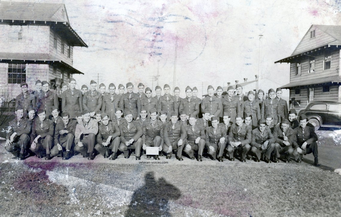 """Fort Custer 10__"" - A 1942 training platoon or company real photo postcard from World War II.  Sent by Pvt. Elmer Stevens (kneeling 5th or 6th from left)."