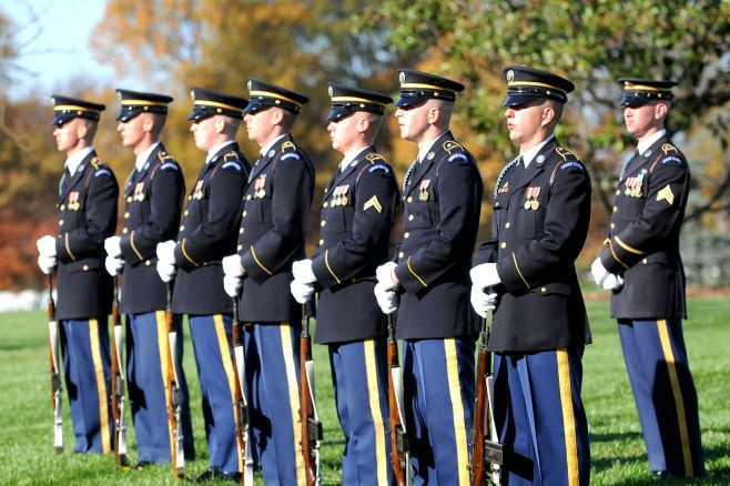 Members of the U.S. Army Ceremonial Honor Guard prepare for the 21-gun salute in Arlington National Cemetery, Nov. 17, 2009. U.S. Navy Petty Officer 3rd Class William Selby