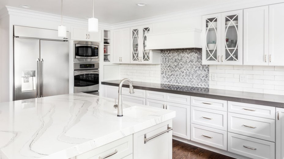 white kitchen with dark countertops