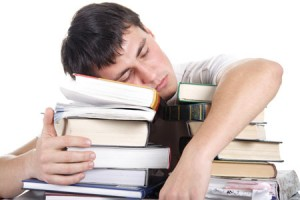 student-sleeping-on-books-300x2001