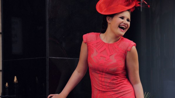 Female model with red dress and hat, fashion videographer leeds