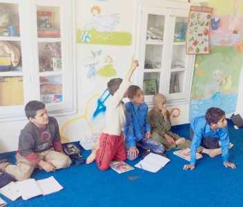 Children in the Street Kids program studying Dari & math
