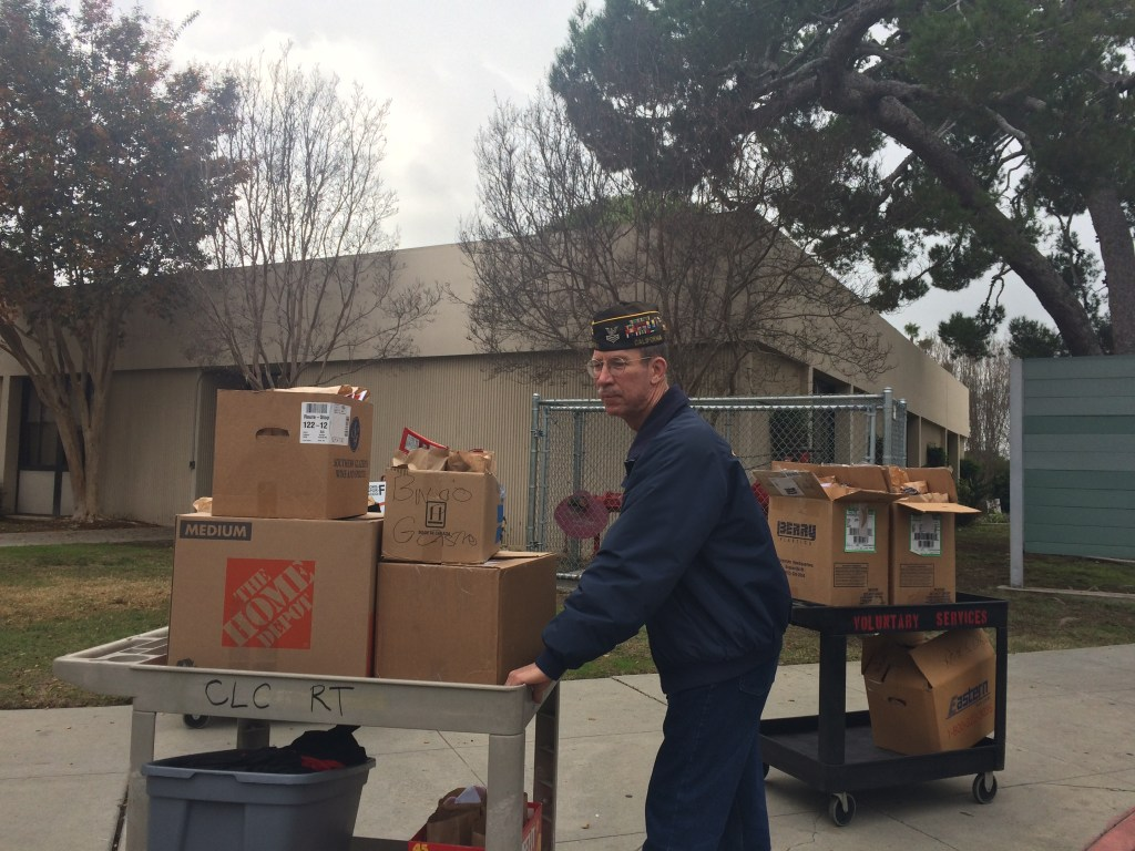 VFW member helping deliver the girt bags to the CLC