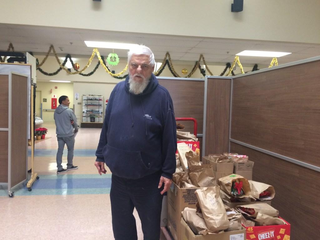 VFW Post 9934 Dana Point member Raymond Kuehl loading the gift bags