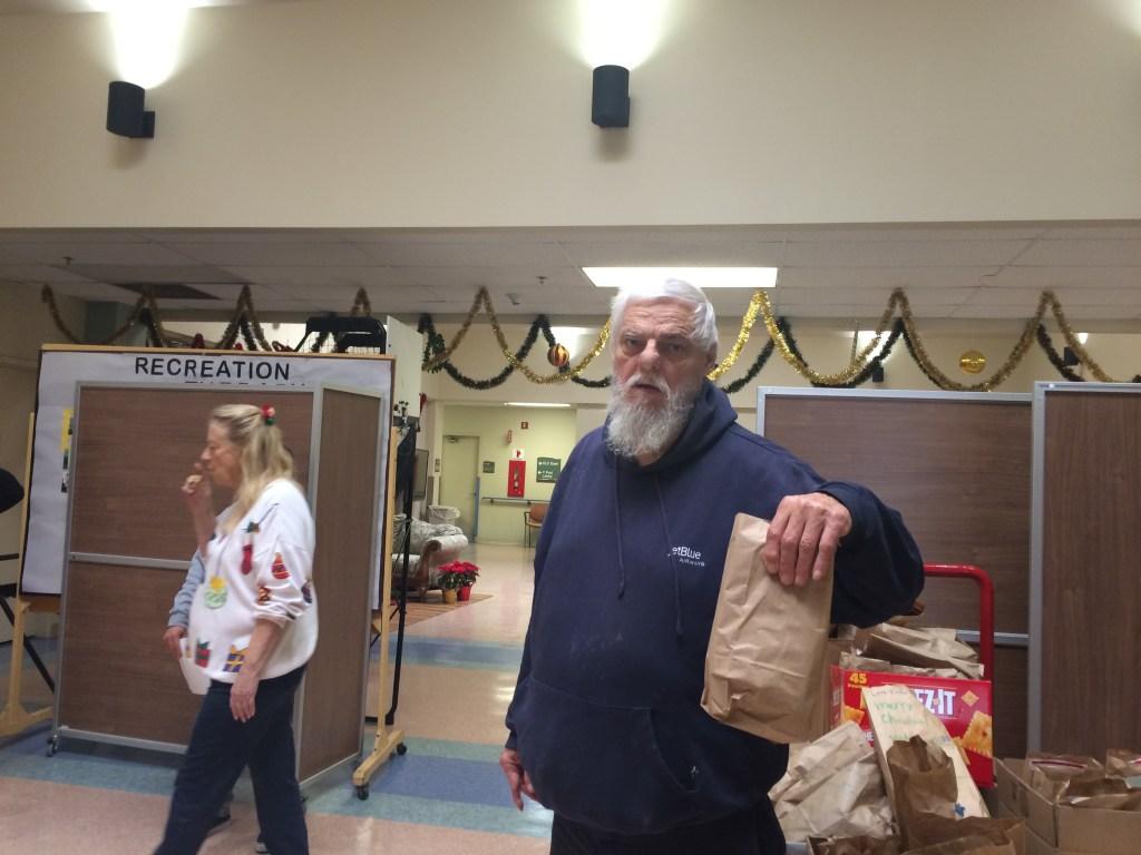 VFW Post 9934 Dana Point member Raymond Kuehl handing out gift bags
