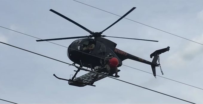 helicopter installation of a power line marker