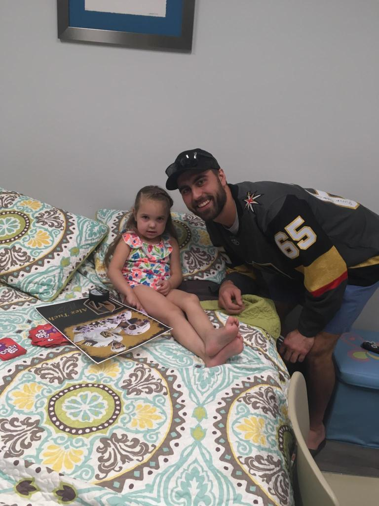 #89 for Vegas Golden Knights, Alex Tuch, poses for a picture with Cami Zemp. Tuch is sporting that #65 jersey signed by all the kids at the Cystic Fibrosis Foundation in Las Vegas. Cami is sporting a beautiful green, pink, and blue floral outfit.