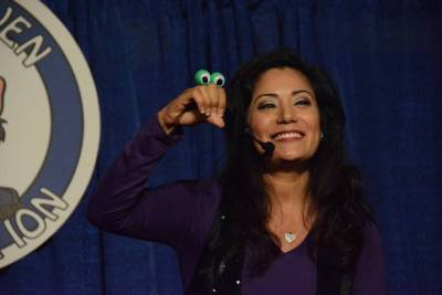 Yoly makes her puppet smile