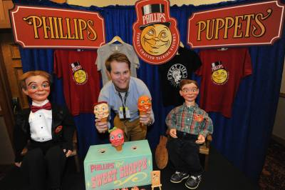 Austin Phillips at his Phillips Puppets table