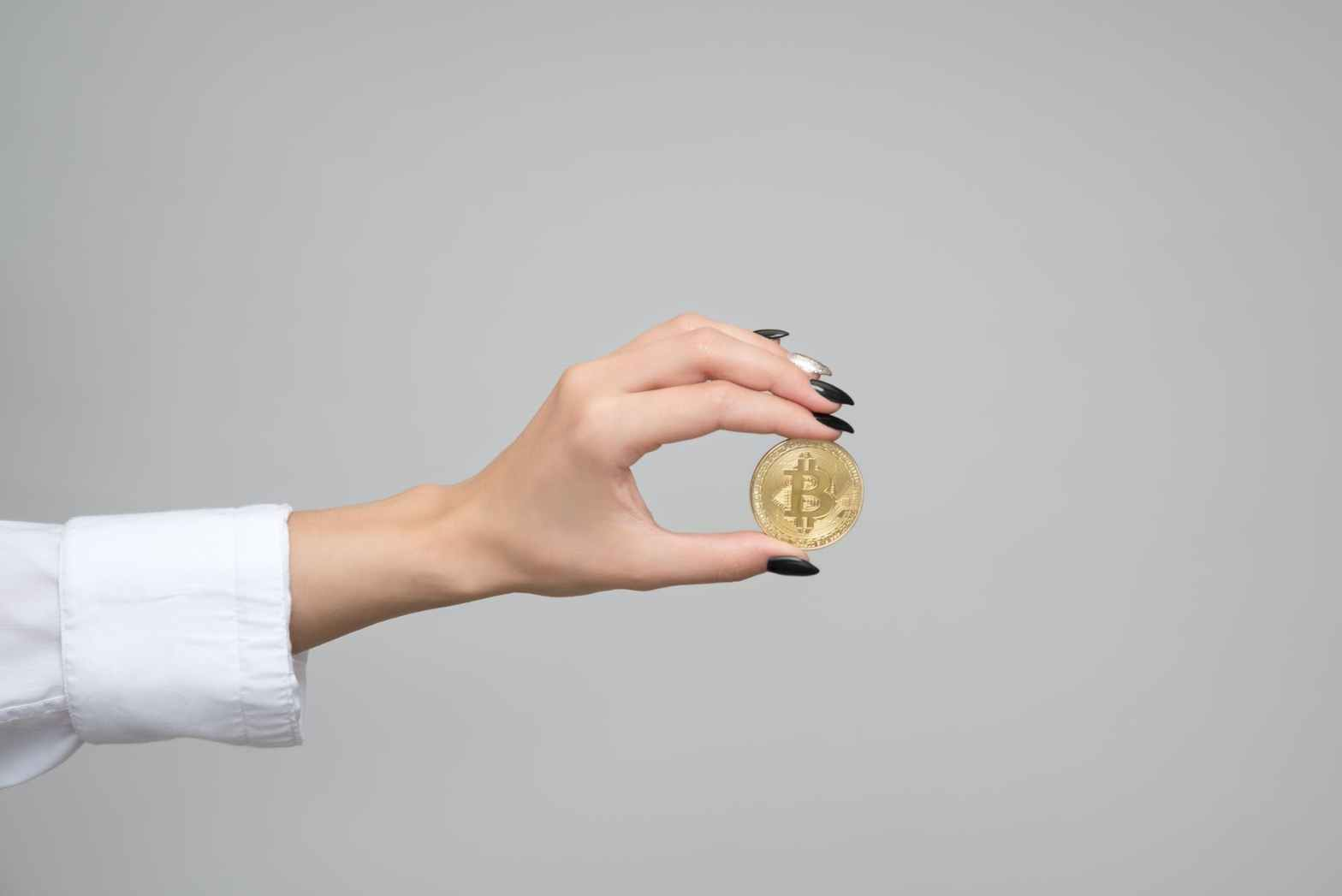 woman holding a bitcoin