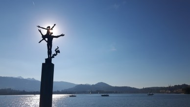 Dancing couple in the sunlight, Lido Lucerne