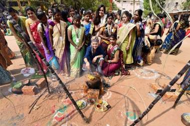 Chennai: A foreigner with other college students celebrating Pongal festival at their college premises in Chennai on Wednesday. PTI Photo (PTI1_11_2017_000249A)