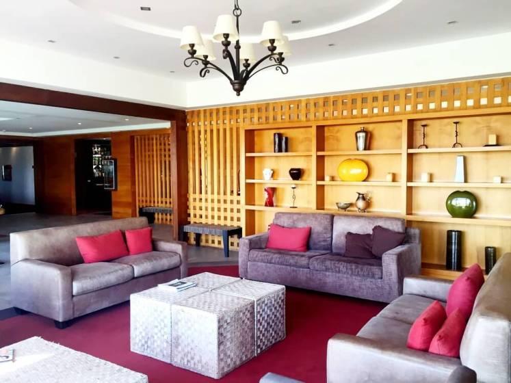 Sala de estar no lobby do Rochester Hotel Calafate