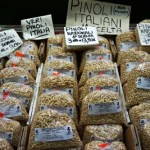 Pinoli su un banco del Mercato Orientale di Genova.