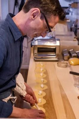 Making fresh pasta at Un Posto Italiano, an Italiano store in Brooklyn.