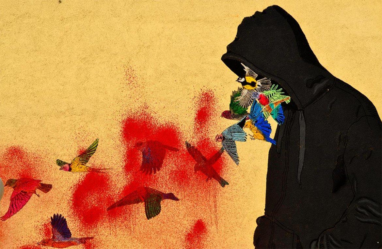 Graffiti hombre capucha pájaros pared calles sureste Berlín