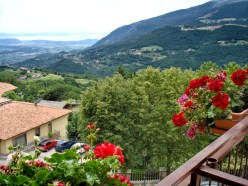 "The view from my hotel in the village of Spiazzi - ""Hotel Posta"". The surrounding mountains and Lake Garda are visible in the distance."