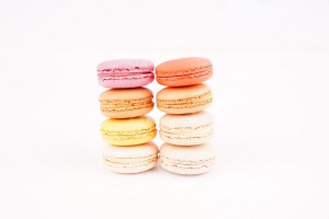 Traditional french colorful macarons on white