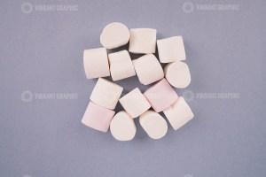 White marshmallow on purple background stock photo