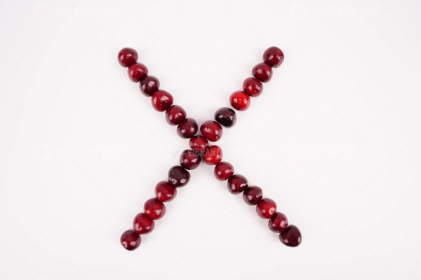 X Letter with cherries stock image