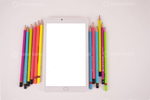 Color pencils and white tablet pc