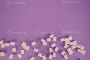 Lump sugar on purple stock photo