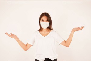 Beautiful woman wearing medical mask