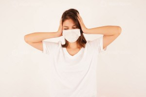 Depressed woman wearing medical mask