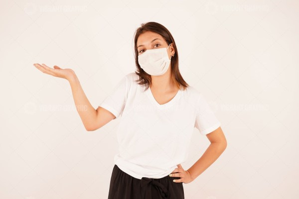 Woman in medical mask holding palm up